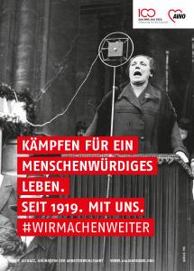 Plakat mit Marie Juchacz und dem Slogan: Kämpfen für ein menschenwürdiges Leben. Seit 1919. Mit uns. Wir machen weiter